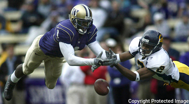 California Bear safety Nnamdi Asomugh (2) breaks up a pass intended for Husky wide receiver Reggie Williams during the Huskies 34 to 27 loss to the Bears on Saturday, Oct., 5, 2002 at Husky Stadium., Sept., 29, 2002  Williams went onto break over 100 yards receiving. (AP Photo/Jim Bryant)