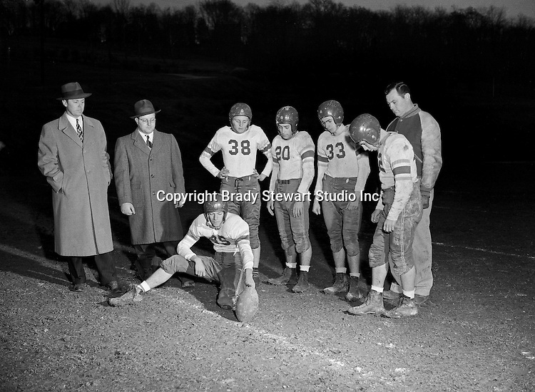Mount Lebanon PA:  The Mount Lebanon Wildcats football team practicing behind the High School. Big Jim Daniell was coaching the team. Big Jim played college football at Ohio State and professional football for the Chicago Bears and Cleveland Browns  - 1947