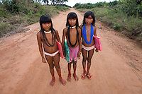 Xingu Indian girls walking to school in the village, Amazon Basin, Brazil.