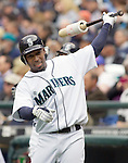 Seattle Mariners Chone Figgins warms up in the on deck circle against the Oakland Athletics in the opening home game of the season at SAFECO Field in Seattle April 12, 2010. The Athletics beat the Mariners 4-0. Jim Bryant Photo. &copy;2010. ALL RIGHTS RESERVED.