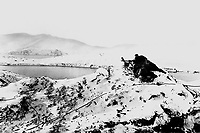 On high ground overlooking an icy inlet in Alaska, U.S. Marines man a machine gun at a lookout post.  Ca. 1942-43.  Marine Corps.  (OWI)<br /> Exact Date Shot Unknown<br /> NARA FILE #:  208-N-8480<br /> WAR &amp; CONFLICT BOOK #:  1146