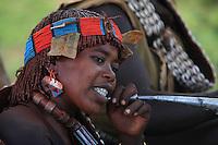 The village of Bori, in the land of the Banas, during the initiation of the young Aïke a woman blows into a horn. ////Village de Bori, pays Bana pendant l'initiation du jeune Aïké, une femme souffle dans une trompe.