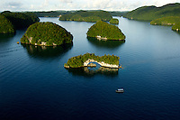 Aerial of the RockIslands in the late afternoon with the Natural Arch in the foreground Palau, <br /> Micronesia