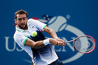 Marin Cilic of Croatia returns the ball to Roger Federer of Switzerland during men semifinal match at the US Open 2014 tennis tournament in the USTA Billie Jean King National Center, New York.  09.05.2014. VIEWpress