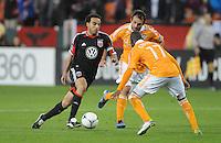 D.C. United forward Dwayne De Rosario (7) goes against Houston Dynamo midfielder Luiz Camargo (17) D.C. United defeated The Houston Dynamo 3-2 at RFK Stadium, Saturday April 28, 2012.