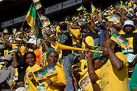 People wear Jacob Zuma t-shirts and wave ANC flags at an African National Congress (ANC) election rally held at the Ellis Park Stadium in Johannesburg..