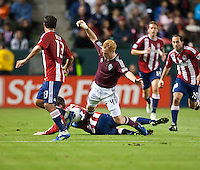 Colorado Rapids midfielder Jeff Larentowicz (4) gets tripped up during the first half of the game between Chivas USA and Colorado Rapids at the Home Depot Center in Carson, CA, on March 26, 2011. Final score Chivas USA 0, Colorado Rapids 1.