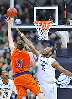 Mike Muscala goes up strong to the basket against Huskies' Charles Okwandu. Connecticut defeated Bucknell 81-52 during the NCAA tournament at the Verizon Center in Washington, D.C. on Thursday, March 17, 2011. Alan P. Santos/DC Sports Box