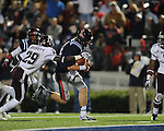 Ole Miss quarterback Bo Wallace (14) scores on a 14 yard run as Texas A&amp;M defensive back Deshazor Everett (29) chases in Oxford, Miss. on Saturday, October 6, 2012. Texas A&amp;M won 30-27...