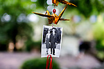 An old photograph of vintner Dick Grace, and his wife, Ann, of Grace Family Vineyards, hangs from a tree in the backyard of their St. Helena home, on Monday, August 31, 2009. The couple have been married for 50 years.