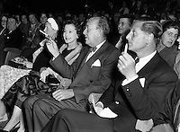 Vivian Leigh with Noel Coward at Olympia Theatre.04/10/56..Vivien Leigh, Lady Olivier (05/11/1913 - 07/07/1967) was an English actress. She won the Best Actress Academy Award for her portrayal of Blanche DuBois in A Streetcar Named Desire (1951), a role she also played on stage in London's West End, as well as for her portrayal of the southern belle Scarlett O'Hara, alongside Clark Gable, in the epic American Civil War drama Gone with the Wind..She was a prolific stage performer, frequently in collaboration with her then-husband, Laurence Olivier, who directed her in several of her roles. During her 30-year stage career, she played roles ranging from the heroines of No&euml;l Coward and George Bernard Shaw comedies to classic Shakespearean characters such as Ophelia, Cleopatra, Juliet and Lady Macbeth..Lauded for her beauty, Leigh felt that it sometimes prevented her from being taken seriously as an actress. However, ill health proved to be her greatest obstacle. For much of her adult life Leigh suffered from bipolar disorder. She earned a reputation for being difficult to work with, and her career suffered periods of inactivity. She also suffered recurrent bouts of chronic tuberculosis, first diagnosed in the mid-1940s. Leigh and Olivier divorced in 1960, and she worked sporadically in film and theatre until her death from tuberculosis in 1967..Sir No&euml;l Peirce Coward (16/12/1899 - 26/03/) was an English playwright, composer, director, actor and singer, known for his wit, flamboyance, and what Time magazine called &quot;a sense of personal style, a combination of cheek and chic, pose and poise&quot;..Born in Teddington, a suburb of London, Coward attended a dance academy in London as a child, making his professional stage d&eacute;but at the age of eleven. As a teenager he was introduced into the high society in which most of his plays would be set. Coward achieved enduring success as a playwright, publishing more than 50 plays from his teens onwards. Many of his works, such as
