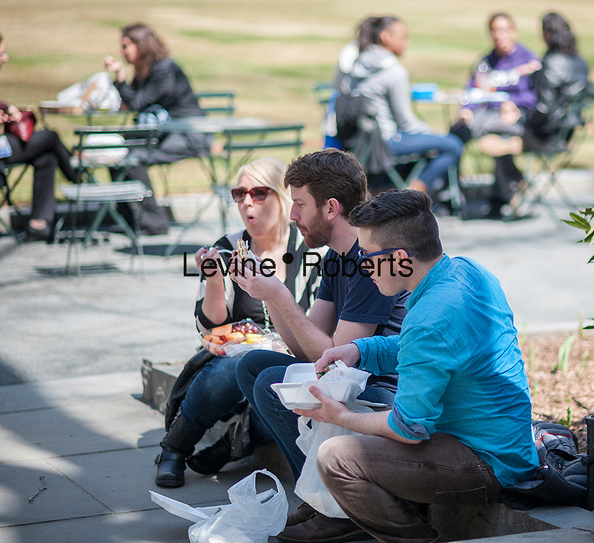 Visitors eat lunch in Bryant Park in New York City while enjoying the warm weather   on Thursday, April 3, 2014.  Temperatures are expected to rise into the mid 60's with plenty of sun today and Friday but clouds and a chance of showers arrive over the weekend.  (© Richard B. Levine)