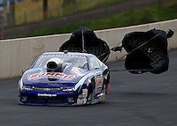 Jul. 19, 2014; Morrison, CO, USA; NHRA pro stock driver Jason Line during qualifying for the Mile High Nationals at Bandimere Speedway. Mandatory Credit: Mark J. Rebilas-