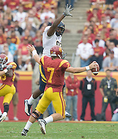 Cameron Jordan of California tries to block Matt Barkley of USC during the game at LA Memorial Coliseum in Los Angeles, California.  USC defeated California, 48-14.