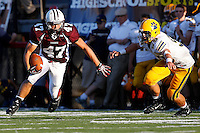 Tom Schlett #47 of Don Bosco evades a tackle by James Sheehan #59 of St Ignatius after catching a pass during the game at Harding Stadium in Steubenville, OH on September 25, 2010. ..Jared Wickerham.