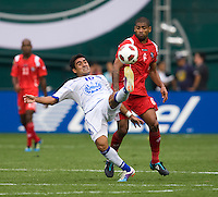 Gabriel Gomez (6) of Panama fights for the ball with Eliseo Quintnilla (10) of El Salvador  during the game at RFK Stadium in Washington, DC.  Panama defeated El Salvador on penalty kicks, 5-3, after tying, 1-1,  in regulation time.