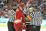 07 APR 2012:  Referees step in to break up a fight between Travis Ouellette (9) of Ferris State University and Tommy Cross (4) of Boston College during the Division I Men's Ice Hockey Championship held at the Tampa Bay Times Forum in Tampa, FL.  Boston College defeated Ferris State 4-1 to win the national title.  Matt Marriott/NCAA Photos