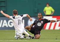 Julius James #2 of D.C. United and Chris Birchall #11 of the Los Angeles Galaxy go for the ball during an MLS match at RFK Stadium on July 18 2010, in Washington D.C. Galaxy won 2-1.