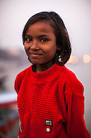Mili, 7, poses for a portrait on the Boat School Guria runs on the holy Ganges River, in Varanasi, Uttar Pradesh, India on 19 November 2013. The school, accommodating almost 50 children, aims to take the boatmen's children away from working in the tourist areas where they are exposed to trafficking and sexual abuse.