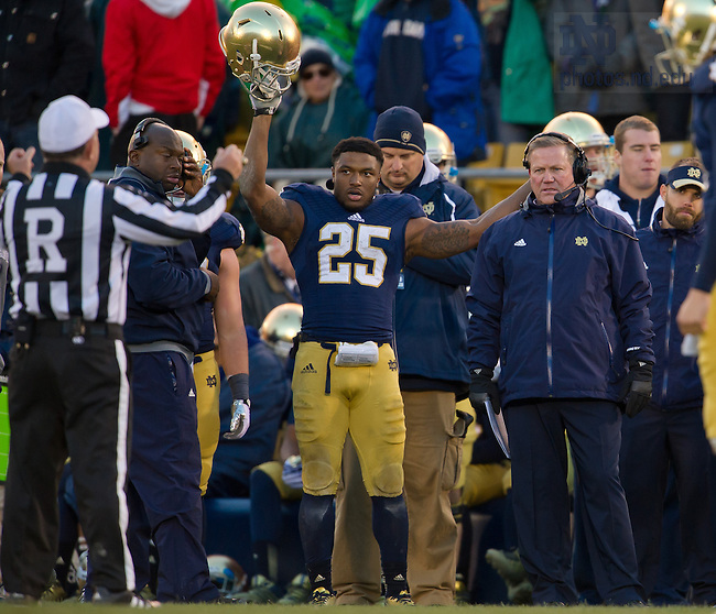 Nov. 2, 2013; Running back Tarean Folston (25) signals touchdown as the referee announces the result of a reviewed play against Navy.<br /> <br /> Photo by Matt Cashore