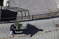 Man with plant, Bubion, Alpujarra, Andalucia, Southern Spain. Photograph by Manuel Cohen.
