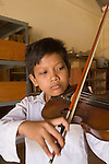 Cambodia boy learns classical violin