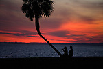 A couple watches the sunset at Shell Point in Wakulla County along the Forgotten Coast south of Tallahassee January 23, 2009.     (Mark Wallheiser/TallahasseeStock.com)