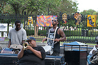 These New Orleans street musicians play their music in Jackson Square along with artist who put up their art for sale on the fences as tourist crowd into the area.