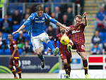 St Johnstone v Motherwell...22.08.15  SPFL   McDiarmid Park, Perth<br /> Jake Taylor clears from Murray Davidson<br /> Picture by Graeme Hart.<br /> Copyright Perthshire Picture Agency<br /> Tel: 01738 623350  Mobile: 07990 594431