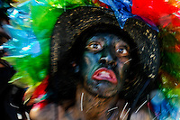 A Colombian man, member of the group Son de Negro, dances during the Carnival in Barranquilla, Colombia, 26 February 2006. The Carnival of Barranquilla is a unique festivity which takes place every year during February or March on the Caribbean coast of Colombia. A colourful mixture of the ancient African tribal dances and the Spanish music influence - cumbia, porro, mapale, puya, congo among others - hit for five days nearly all central streets of Barranquilla. Those traditions kept for centuries by Black African slaves have had the great impact on Colombian culture and Colombian society. In November 2003 the Carnival of Barranquilla was proclaimed as the Masterpiece of the Oral and Intangible Heritage of Humanity by UNESCO.