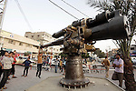 A Palestinian boy play on an old canon that was found by Palestinian fishermen in the waters of the Mediterranean Sea in front of the Gaza Strip coast, at the main square in Deir al-Balah, central Gaza Strip, Thursday, Oct. 31, 2013. Palestinian officials said the canon is believed to have been erected on an enemy warship of the Ottoman Empire in the Mediterranean Sea. Photo by Ashraf Amra