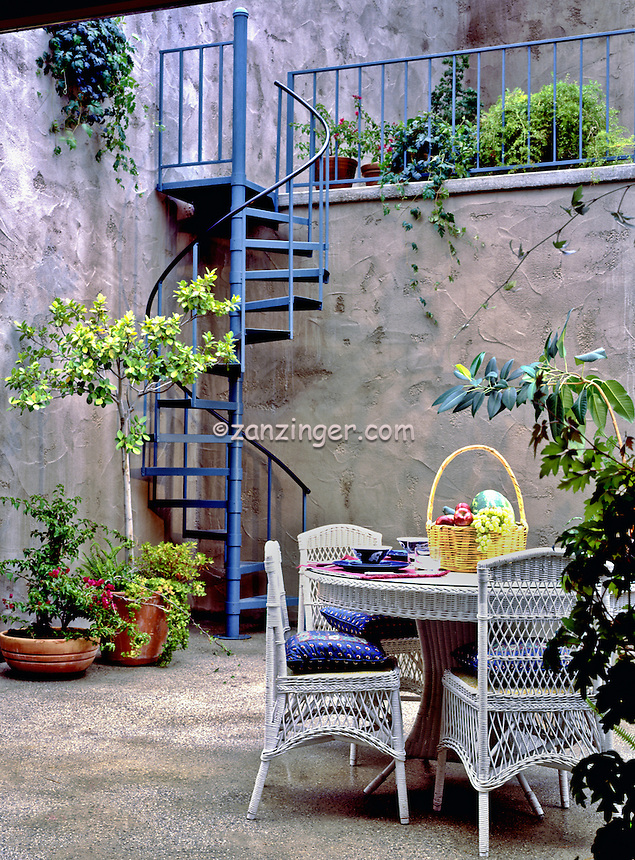 Outdoor Iron Sprial Stairway, wicker table and chairs, Design, lifestyle, room, interior, trendy, residence, home, house, .jpg