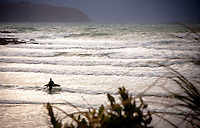 Onshore winds whip up waves at Titahi Bay on a overcast winters day. A lone surfer ventures out to make the most of the first swell in weeks.
