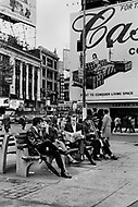 Times Square, New York City. May 1969. Picture of Yves Montand reading in a park in Times Square. Yves Montand (October 13, 1921 - November 9, 1991) was an Italian-born French actor and singer, who was discovered by renown singer ´Edith Piaf, and is most known for his performance in the movie Jean de Florette.