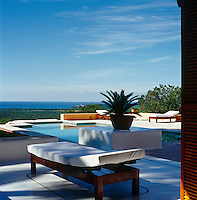 Another of the terrace swimming pools on the property is furnished with simple sun loungers