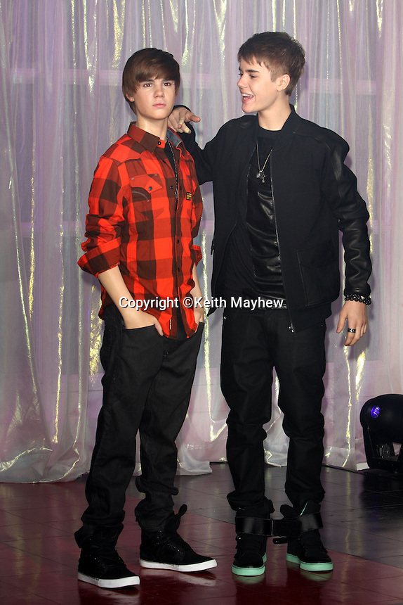 London - Justin Bieber unveils his new waxwork model at Madame Tussauds, London - March 15th 2011l..Photo by Keith Mayhew