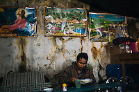 Khasi man having dinner in a rundown restaurant at Lytringen in East Khasi Hills - the wettest place on Earth. Arindam Mukherjee