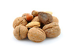 Mixed nuts on white background with amonds, hazelnuts, and walnuts