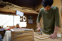 Ryoichiro Mishina of Iwayado Tansu Seisakujo making a frame for a chest of drawers, Oshu City, Iwate Prefecture, Japan, July 18, 2013. Iwayado Tansu chests of drawers have been made in the city of Oshu since the 1780s. They are noted for their fine lacquer finish and finely-wrought metalwork fittings.