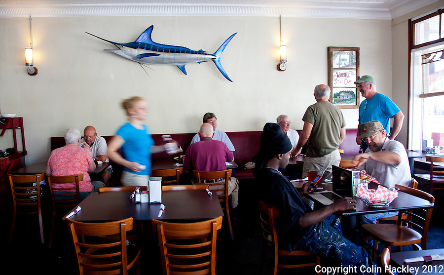LUNCHTIME RUSH: A server blurs through the thickening crowd at the Brick House Eatery on Jefferson Street..COLIN HACKLEY PHOTO