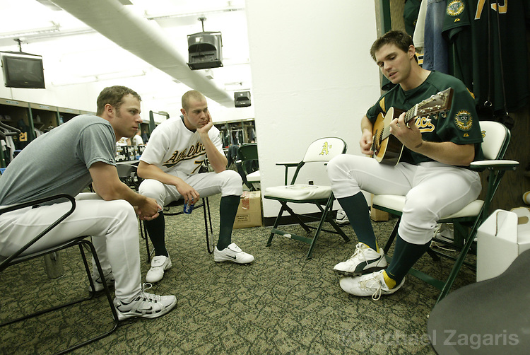 OAKLAND, CA - JUNE 5:  Rich Harden and Bobby Crosby listen to Barry Zito of the Oakland Athletics before the MLB game against the Toronto Blue Jays at Network Associates Coliseum on June 5, 2004 in Oakland, California. The A's defeated the Blue Jays 4-0. (Photo by Michael Zagaris/MLB Photos via Getty Images)