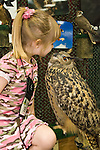 "Rachel Wood with her ""very much alive"" Eagle Owl friend on exhibit with The Raptor Project at the Rio Grande Valley Nature Festival.  Rachel helps her parents Susan and Jonathan Wood do educational programs at festivals and schools and featuring a variety of live raptors from around the world."