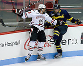 Braden Pimm (NU - 14),Tom McCarthy (Merrimack - 6) - The Northeastern University Huskies defeated the visiting Merrimack College Warriors 4-2 (EN) on Wednesday, October 10, 2012, at Matthews Arena in Boston, Massachusetts.