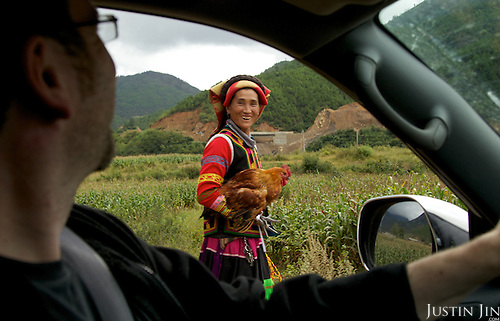 A woman belonging to the musui minority walks past our car in Yunnan province.