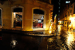A corner local's restaurant on a rainy night in Cartagena.