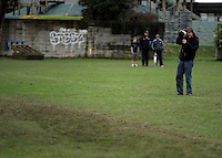 Sunday Star-Times photographer Kevin Stent walks onto the playing field to shoot injured All Black Ma'a Nonu..Wellington Club Rugby - Jubilee Cup, Upper Hutt v Oriental-Rongota at Maidstone Park, Upper Hutt, Wellington, Saturday, 26 June 2010. Photo: Dave Lintott/lintottphoto.co.nz