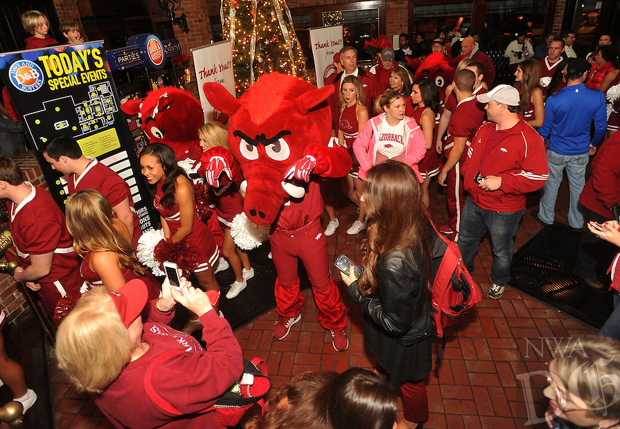 NWA Media/Michael Woods --12/28/2014-- w @NWAMICHAELW...Razorback fans snap photos of  the Razorback mascots and cheerleaders as the arrive at Dave and Busters Sunday night in Houston for a pep rally.  The Razorbacks take on the Texas Longhorns in the Texas Bowl Monday night.