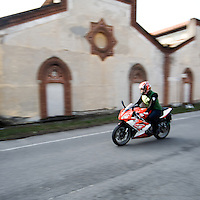 Motociclista tra le vie di Crespi d'Adda<br /> <br /> Bikers on the road of Crespi d'Adda