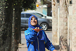 """Sawsan Al Khalili, 40 years-old, a Palestinian woman of special needs plays table tennis in Gaza city on Feb. 11, 2017. Al Khalili secretary general of the general union of the Palestinian disabled and a head of the Palestinian farsat club for women with disabilities and she has a degree in law and information technology. """"I defend the rights of the disabled and became their ambassador in six European countries"""" Al Khalili said. Photo by Samar Eliwa"""