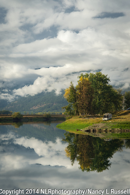 Clouds reflecting on the Kootenai River in north Idaho in the fall